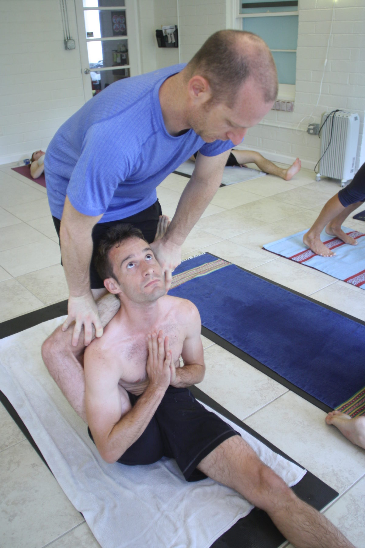 Jared-getting-help-with-difficult-yoga-practice